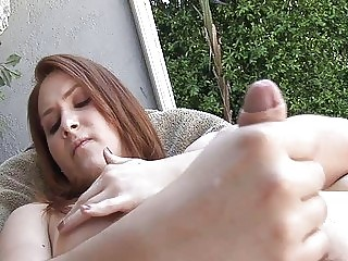 Redhead cutie massages her twat and sucks a prick outdoors