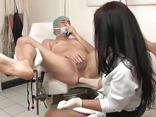 Brunette doctor examines patient's prostate with her fist and toys