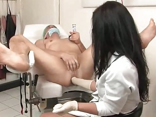 Gorgeous nurse fists the bulky patient during the prostate exam