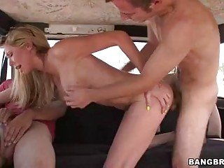 Turned on blonde enjoying in threesome in back of the van