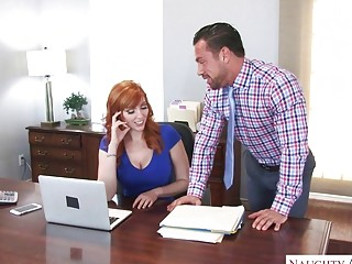 Foxy redhead gives blowjob and gets licked in an office