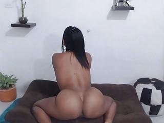 Busty Venezuelan chick shows of tits while masturbating on camera