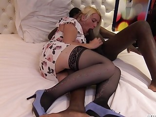 Mature babe sucks huge black cock in a hotel room