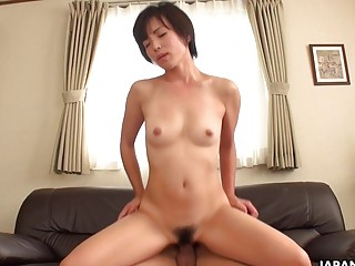 Japanese brunette Hasumi rides hard dick uncenso